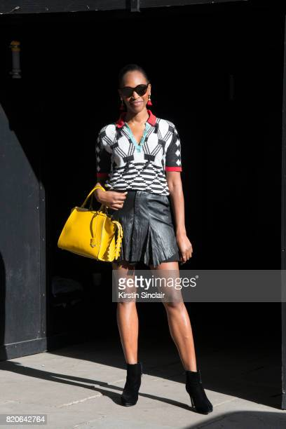 Publisher of the British GQ Vanessa Kingori wears a Fendi bag Maxhosa shirt and a Konsanszky skirt on day 1 of London Collections Men on June 9 2017...