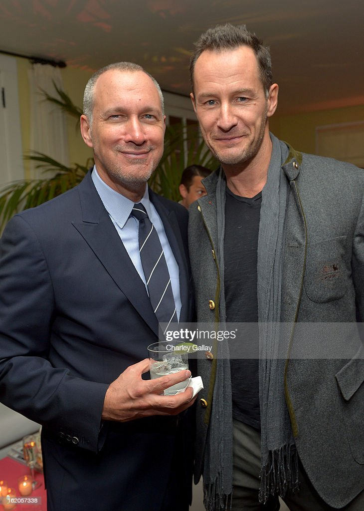 """Publisher of Vanity Fair Edward Menicheschi and photographer Sebastian Copeland attend Vanity Fair and Juicy Couture's Celebration of the 2013 """"Vanities"""" Calendar hosted by Vanity Fair West Coast Editor Krista Smith and actress Olivia Munn in support of the Regional Food Bank of Oklahoma, a member of Feeding America, at the Chateau Marmont on February 18, 2013 in Los Angeles, California."""