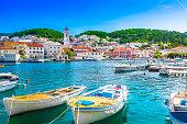 Seafront scenery of small mediterranean village Pucisca on Island Brac, tourist summer resort in Croatia, Europe.