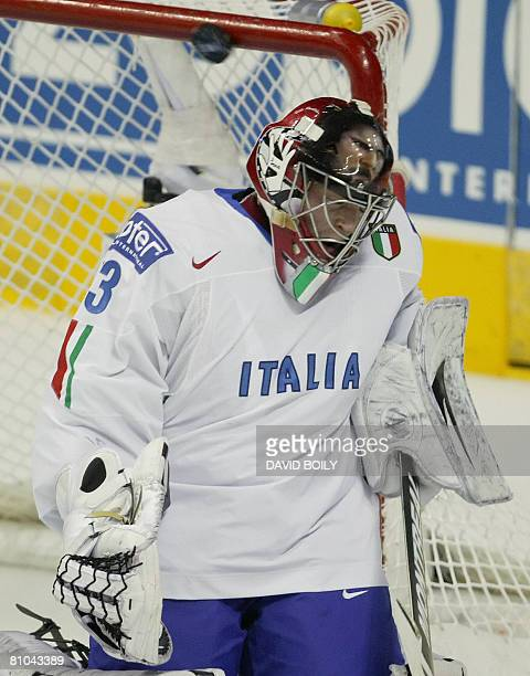 A puck hits the crossbar over the shoulder of Italian goaltnder Guenther Hell in the first period during the relegation round at the 2008 IIHF World...