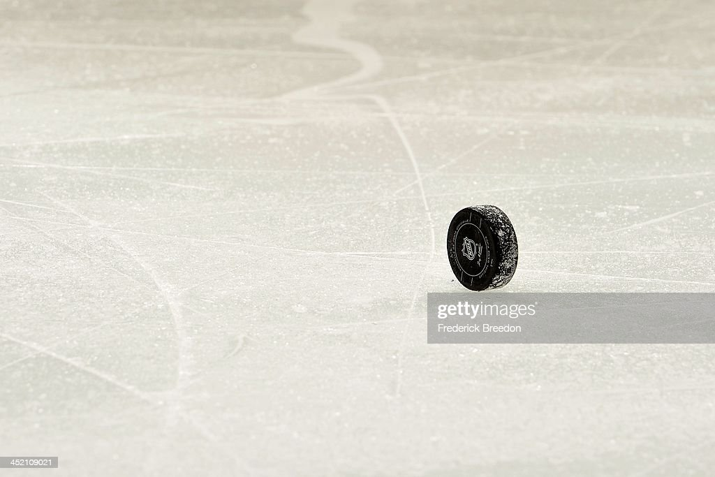 A puck rests on its side during a game between the Nashville Predators and the Phoenix Coyotes at Bridgestone Arena on November 25, 2013 in Nashville, Tennessee.