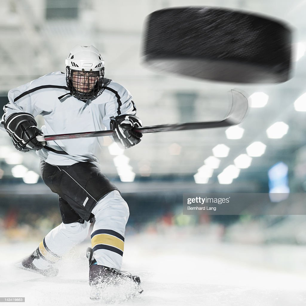 Puck shot by Ice hockey player : Stock Photo