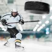 Puck shot by Ice hockey player