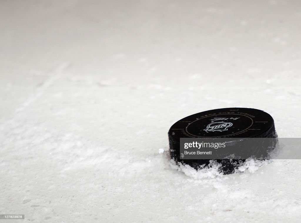 A puck sits on the ice during the game between the New Jersey Devils and the Philadelphia Flyers at the Wells Fargo Center on September 29 2011 in...