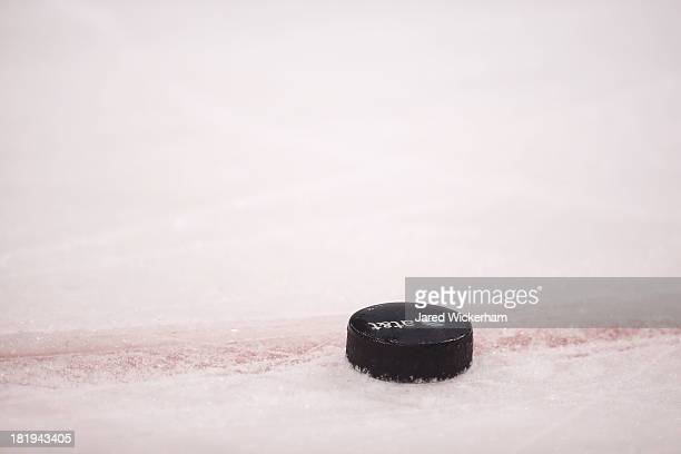 A puck with an ATT logo sits on the ice during warm ups prior to the game between the Boston Bruins and the Washington Capitalsduring the game on...