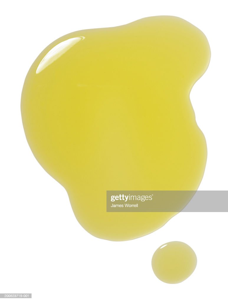 Puddle of olive oil on white background : Stock Photo