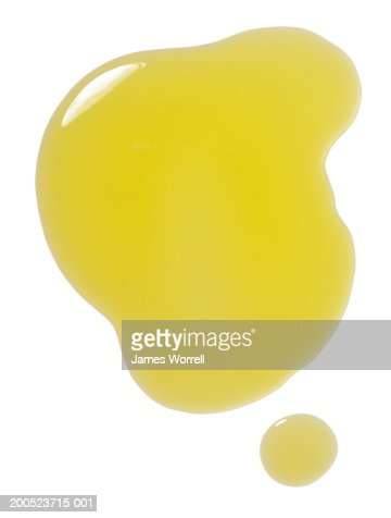 Puddle of olive oil on white background