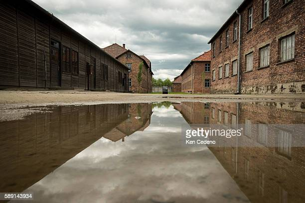 A puddle of water lies between buildings inside the former NaziGerman concentration and extermination camp AuschwitzBirkenau in Oswiecim Poland May...