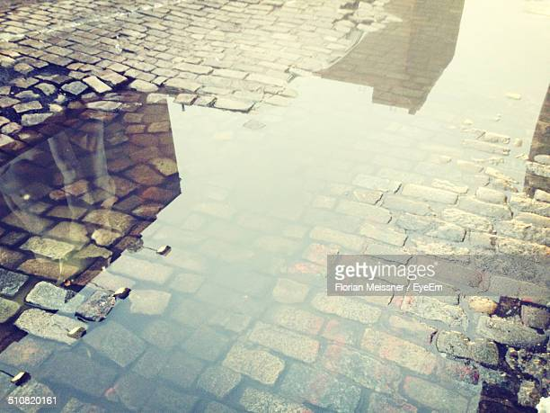 Puddle on cobbled street