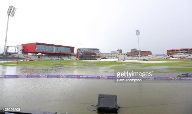 Puddles form on the outfield as rain continues to fall before the start of the Natwest T20 Blast Quarter Final match between Lancashire Lightning and...