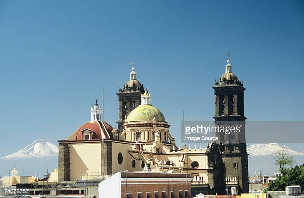 Puebla cathedral and volcanoes