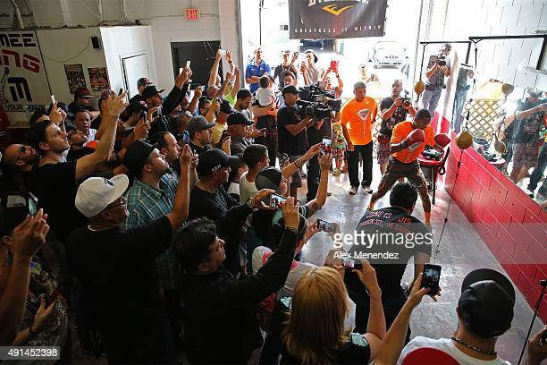 Puerto Rican boxer Felix Verdejo is seen hitting a bag as fans surround him during his media workout event at the Kissimmee Boxing Gym on October 4...