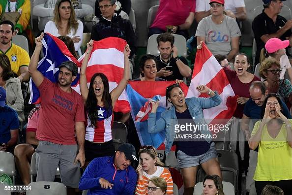 Puerto Rican fans attend the women's singles final tennis match at the Olympic Tennis Centre of the Rio 2016 Olympic Games in Rio de Janeiro on...