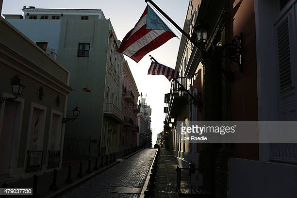 Puerto Rican flag flies from a building a day after the speech Puerto Rican Governor Alejandro Garcia Padilla gave regarding the government's $72...