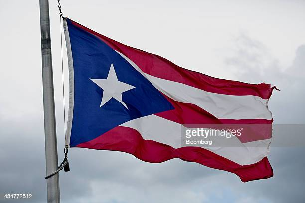 A Puerto Rican Flag flies in Old San Juan Puerto Rico on Tuesday Aug 18 2015 Puerto Rico bonds may become attractive after the junkrated commonwealth...