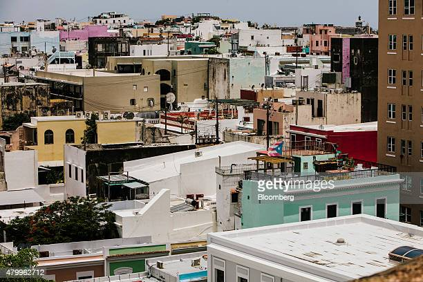 A Puerto Rican flag flies on top of a building in the Old City of San Juan Puerto Rico on Wednesday July 8 2015 A growing number of Republicans in...
