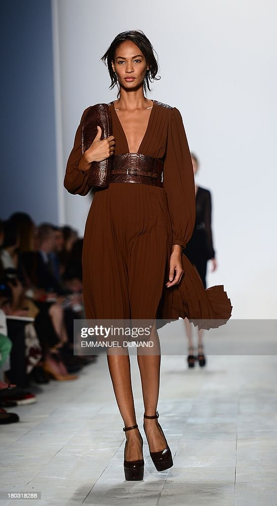 Puerto Rican model Joan Smalls displays creations by designer Michael Kors during the Mercedes-Benz Fashion Week Spring 2014 collection in New York on September 11, 2013. AFP PHOTO/Emmanuel Dunand