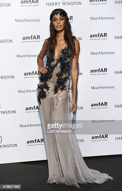 Puerto Rican model Joan Smalls poses as she arrives for the amfAR dinner on the sidelines of the Paris fashion week in Paris on July 5 2015 AFP PHOTO...
