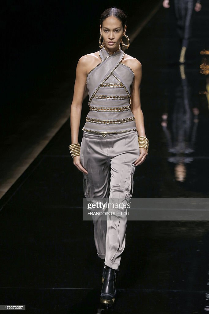 Puerto Rican model Joan Smalls presents a creation for Balmain during the 2014/2015 Autumn/Winter ready-to-wear collection fashion show, on February 27, 2014 in Paris. AFP PHOTO / FRANCOIS GUILLOT