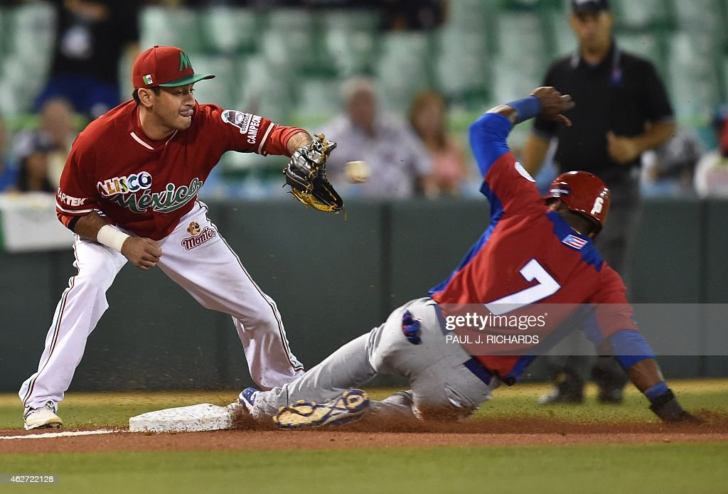 Puerto Rican National baseball team player (R) beats the throw to Mexican National team third baseman <a gi-track='captionPersonalityLinkClicked' href=/galleries/search?phrase=Oscar+Robles&family=editorial&specificpeople=240426 ng-click='$event.stopPropagation()'>Oscar Robles</a> (L) in the second inning of the San Juan Serie Del Caribe February 3, 2015 in San Juan, Puerto Rico.