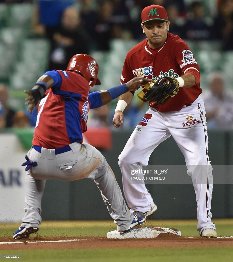Puerto Rican National baseball team player beats the throw to Mexican National third baseman Oscar Robles in the second inning of the San Juan Serie...