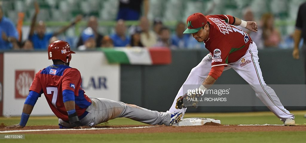 Puerto Rican National baseball team player (L) beats the throw to Mexican National third baseman <a gi-track='captionPersonalityLinkClicked' href=/galleries/search?phrase=Oscar+Robles&family=editorial&specificpeople=240426 ng-click='$event.stopPropagation()'>Oscar Robles</a> (R) in the second inning of the San Juan Serie Del Caribe February 3, 2015 in San Juan, Puerto Rico.