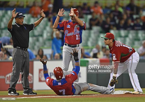 Puerto Rican National baseball team player beats the throw to Mexican National third baseman Oscar Robles before umpire Domingo Polanco and the...