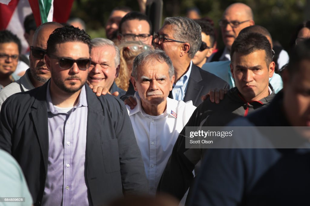 Puerto Rican nationalist Oscar López Rivera (C) walks with supporter to a rally held in his honor on May 18, 2017 in Chicago, Illinois. López, who once lived in Chicago was released from federal custody yesterday, his prison sentence being commuted by President Barack Obama before he left office. Lopez was one of the leaders of the Armed Forces of National Liberation (FALN), a Puerto Rican group that claimed responsibility for more than 100 bombings at government buildings, department stores, banks and restaurants in New York, Chicago, Washington D.C. and Puerto Rico during the 1970s and early 1980s.