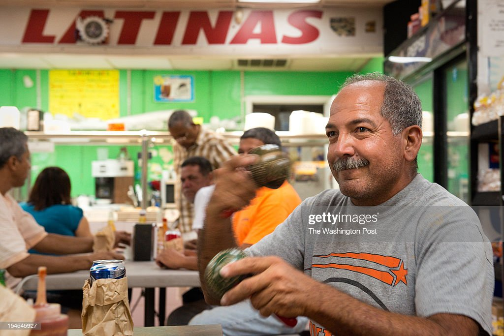 Puerto Rican native Sammy Hernandez plays the maracas at the Dominican owned La Isla Food Center on Route 192 in Kissimmee Florida Hernandez and a...