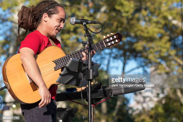 Puerto Rican Nueva Trova musician Fernandito Ferrer plays guitar as he performs during a benefit for SummerStage at Central Park SummerStage New York...