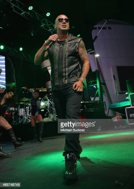 Puerto Rican reggaeton artist Wisin performs at the FIFA World Cup Trophy Tour By CocaCola at LA Live on April 19 2014 in Los Angeles California