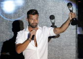 Puerto Rican singer Ricky Martin celebrates after receiving an award during the World Music Awards at Monte Carlo Sporting Club on May 27 2014 in...