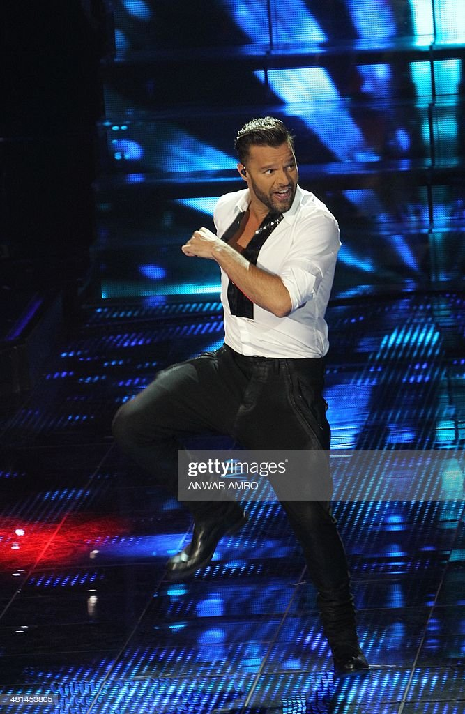 Puerto Rican singer Ricky Martin performs on stage during the final episode of the Arabic television show 'The Voice', aired live from Beirut on March 29, 2014 in Lebanon. Sattar Saad from Iraq won the Saudi-owned TV MBCs Arab version of the reality television singing competition, which featured 100 participants from across the Arab world.