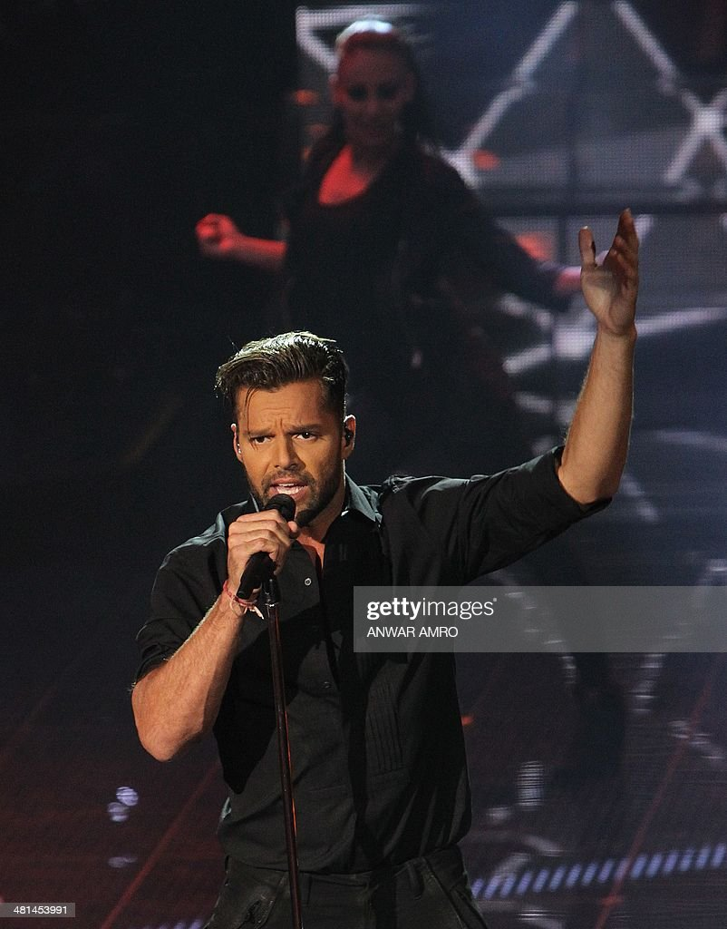 Puerto Rican singer Ricky Martin performs on stage during the final episode of the Arabic television show 'The Voice', aired live from Beirut on March 29, 2014 in Lebanon. Sattar Saad from Iraq won the Saudi-owned TV MBCs Arab version of the reality television singing competition, which featured 100 participants from across the Arab world. AFP PHOTO / ANWAR AMRO