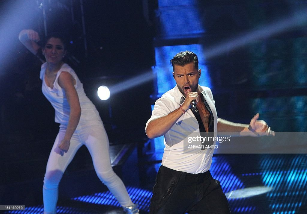 Puerto Rican singer Ricky Martin performs on stage during the final episode of the Arabic television show 'The Voice', aired live from Beirut on March 30, 2014 in Lebanon. Sattar Saad from Iraq won the Saudi-owned TV MBCs Arab version of the reality television singing competition, which featured 100 participants from across the Arab world.