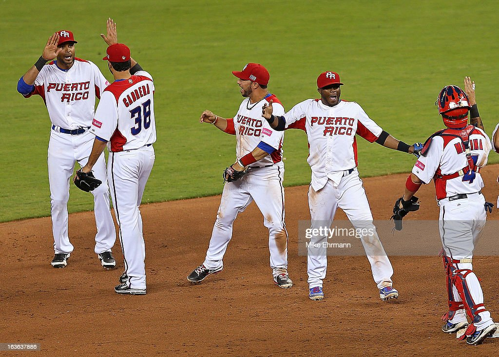 Puerto Rico celebrates after winning a World Baseball Classic second round game against Italy at Marlins Park on March 13, 2013 in Miami, Florida.