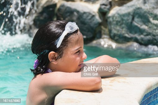 Puerto Rico, Humacao, View of girl (8-9 years) wearing swimming goggle : Stock Photo