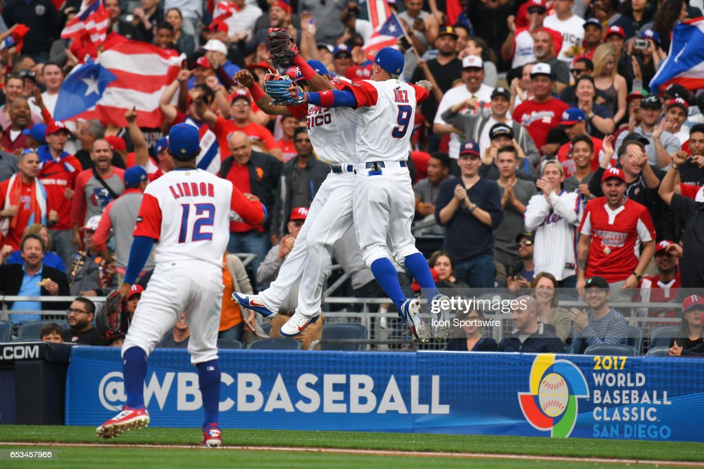 Puerto Rico Outflielder Eddie Rosario celebrates with Puerto Rico Second baseman Javier Baez after throwing out a runner at home to end the first inning of a World Baseball Classic second round Pool F game against Dominican Republic on Tuesday, March 14, 2017 at Petco Park in San Diego, CA.