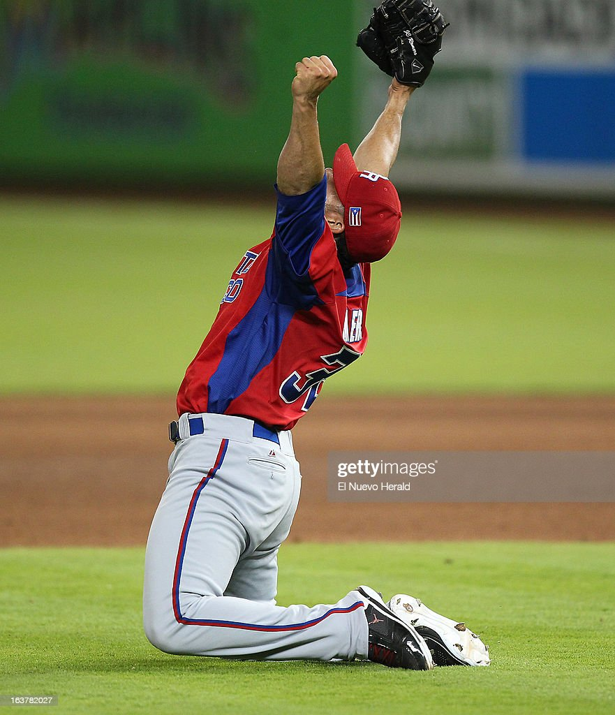 Puerto Rico pitcher J.C. Romero reacts after a 4-3 win against the United States in the World Baseball Classic second round Pool 2 elimination game at Marlins Park in Miami, Florida, on Friday, March 15, 2013.