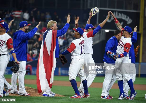 Puerto Rico players celebrate after Puerto Rico beat the Dominican Republic 31 in the World Baseball Classic Pool F Game One at PETCO Park on March...