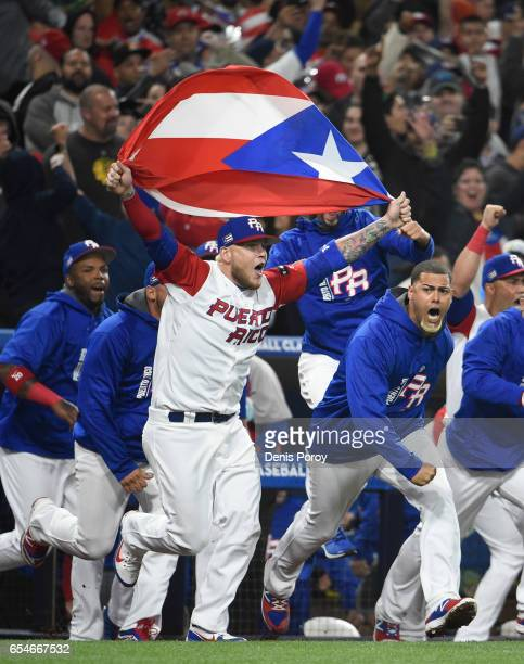 Puerto Rico players celebrate after they beat the United States 65 in the World Baseball Classic Pool F Game Four between the United States and...