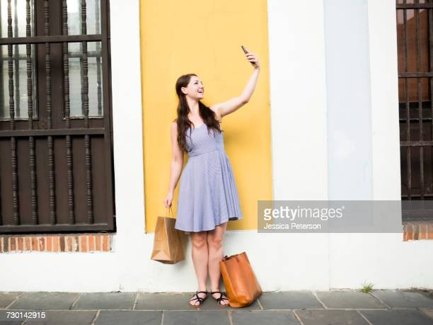 Puerto Rico, San Juan, Beautiful woman doing selfie on city street