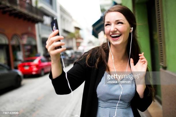 Puerto Rico, San Juan, Woman listening to music on street