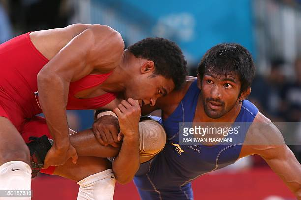 Puerto Rico's Franklin Gomez Matos wrestles India's Yogeshwar Dutt in their Men's 60kg Freestyle repechage round 1 match on August 11 2012 during the...