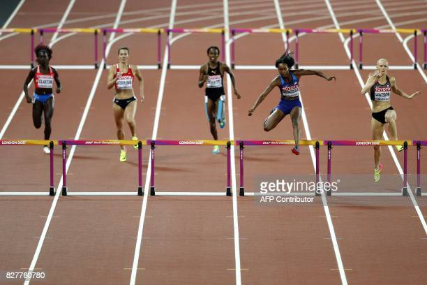 Puerto Rico's Grace Claxton Czech Republic's Denisa Rosolova Jamaica's Rhonda Whyte US athlete Dalilah Muhammad and Canada's Sage Watson compete in a...