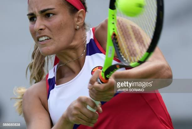 TOPSHOT Puerto Rico's Monica Puig returns the ball to Czech Republic's Petra Kvitova during their women's singles semifinals tennis match at the...