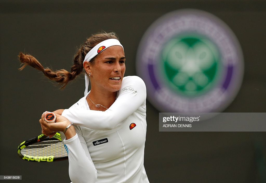 Puerto Rico's Monica Puig returns to Britain's Johanna Konta during their women's singles first round match on the third day of the 2016 Wimbledon Championships at The All England Lawn Tennis Club in Wimbledon, southwest London, on June 29, 2016. / AFP / ADRIAN