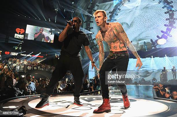 Puff Daddy and Machine Gun Kelly perform onstage at the 2015 iHeartRadio Music Festival at MGM Grand Garden Arena on September 19 2015 in Las Vegas...