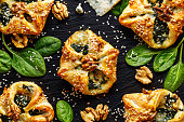 Spinach puffs with addition of Gorgonzola cheese, walnuts and sesame seeds