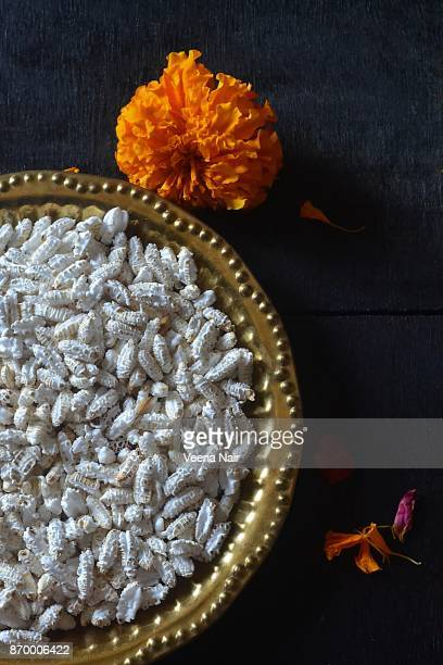 Puffed Rice/Popped Rice in a copper plate with marigold flowers